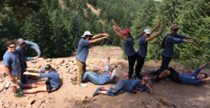 Boulder County Youth Corps - group people posing on a cliff