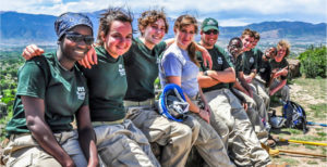 Mile High Youth Corps group shot on a mountain overlook
