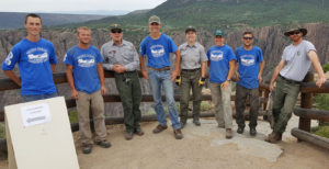 Western Colorado Youth Corps group of corps member on an mountain outlook